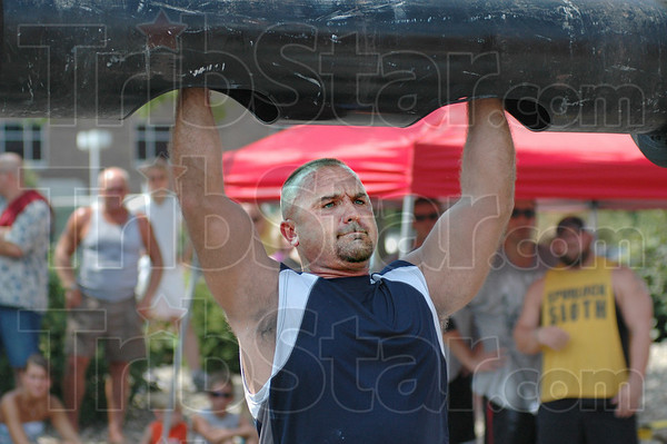 """Log press: Tribune-Star reporter Brian Boyce lifts the """"log"""" during Saturday's Gladiator Challenge sponsored by Union Hospital's Center for Fitness."""