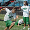 Coach: New York Jets cornerback Marquice Cole (R) gives instruction to All State football camp attendees Saturday morning at North High School. Jets punter and North graduate Steve Weatherford runs the camp.