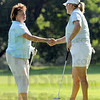 Congrats: Eileen Mann (L) congratulates Rachael Pruett on the 11th hole win of the Women's City Tournament at Rea Park Saturday morning.