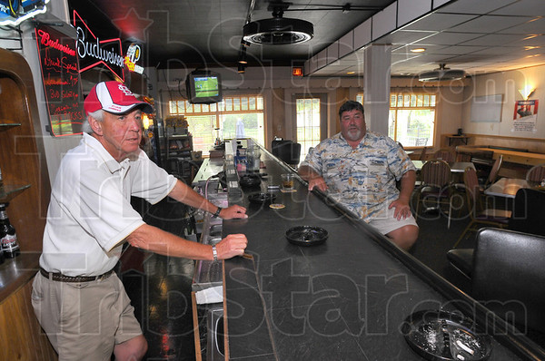 Tough all over: Times are tough even for private clubs Like the Elks in north 25th street. Mannager Frank Perry and bartender Joe Bukovach talk about how the loss of ancilliary income sources, such as poker machines has hurt neighborhood bars and clubs.