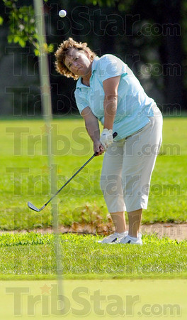 At the pin: Eileen Mann hits a shot on the 11th hole at Rea Park Saturday afternon against Rachael Pruiett. Pruiett won the match on the hole.