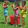 Warm weather fun: One activity at the CASA open house was a water balloon fight. Here Shayla Grady, Jaleigh Briggs and Shayna Elder prepare to do battle.