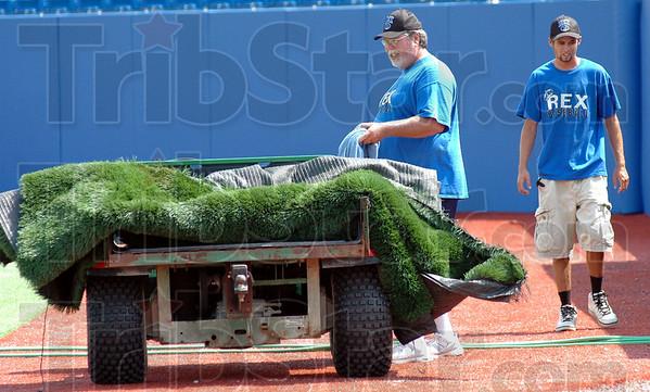 Ground crew: Marty Hendricks (L) and crew member Kyle McFadden prepare Bob Warn Field for a Rex game.