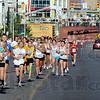 Pack runners: A large group of runners was split by a passing train during the 2010 Mayor's Cup Mile Saturday morning.