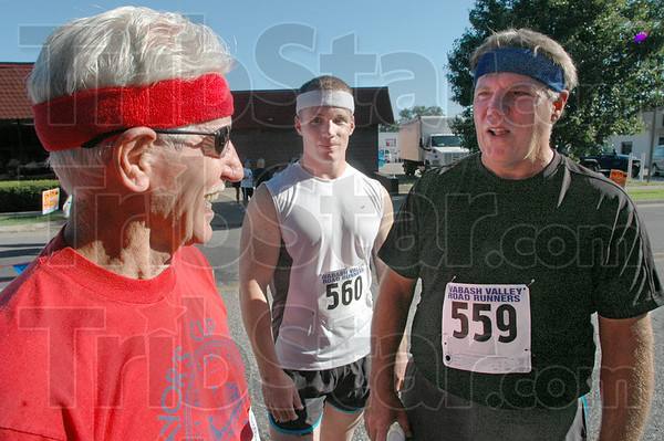 Like father, like son, like son: Bob Lemont (L) talks with his grandson, Bob III (center) and son Bob Jr. after he beat both of them to the finish line in the annual Mayor's Cup Mile.
