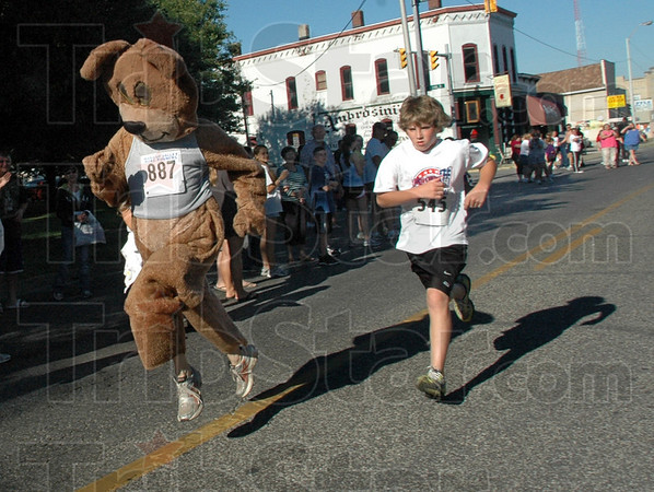 Harry Baer: Thirteen-year-old Zac Otte can't believe he is in a foot-race with a man in a hairy bear suit named Harry Baer as they close in on the finish line of the Mayor's Cup Mile race Saturday morning.