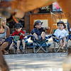Look mom: Triplets Cooper, Colter and Cale Heffernan sit along Wabash Avenue Saturday morning watcing horses parade by during the annual event. Mom Jessica (L) responds to Colter's question about the horses.