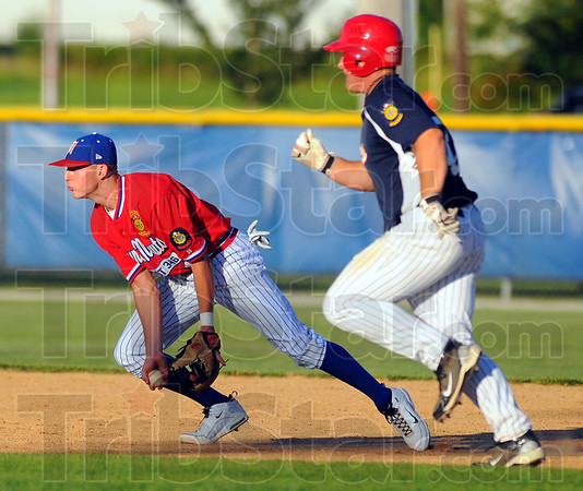 Ahead of the game: Post 346 second baseman Tyler Wampler tosses the ball to Jacob Hayes to force out Greene County baserunner Payton Karl.