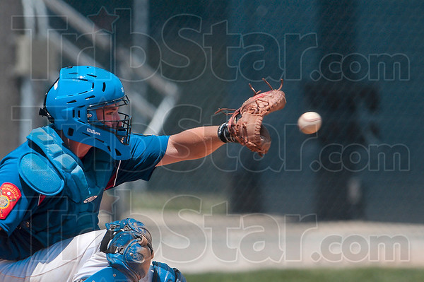 Tribune-Star/Joseph C. Garza<br /> He catches a lot of heat: Wayne Newton Post 346 catcher Dougie Collett catches an A.J. Reed pitch during the team's game against Remington Saturday at Terre Haute North High School.