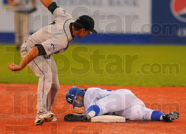 Stick tight: Joel Licon sticks to second base after completing a steal in the Rex-DuPage game Wednesday evening. Dragon shortstop Steve Dalporto tred in vain to make the tag.