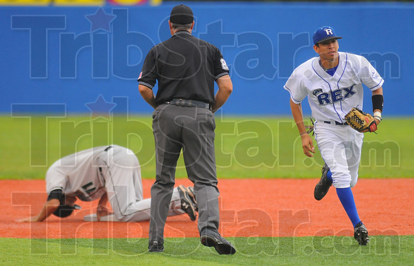 Caught: Dragon baserunner Alex Staehely kneels at second base after being picked off by Rex pitcher Michael Son. Handling the throw and tag was Ray Hernandez.