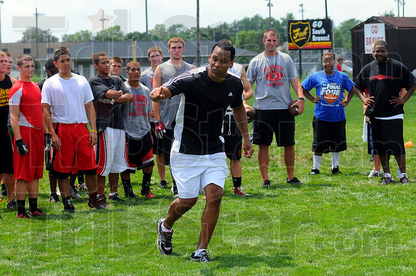 Sell it: Tony Mcgee emphasizes the importance of making a fake move to get free while running a route. McGee and fellow former South Brave Cam Cameron were helping the Brave football team Wednesday afternoon.