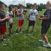 KNows the ropes: Terre haute South quarterback hopefuls listen to Cam Cameron, right as he gives them pointers on improving their performence. QBs are Logan Steward, Taxi Brown, Danny Etling and Jimmy Maxwell.