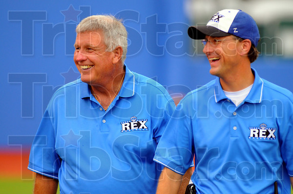 Smiles all around: After throwing out the first pitch, Tommy John walks back to the stands with Gene Crume, President of the ISU Foundation.