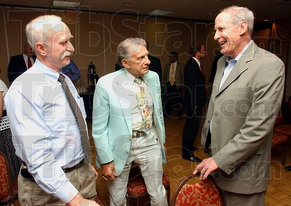 Touring: Vigo county physicians Roland Kohr and Robert Burkle talk with Dan Coats at his Hoosier Voices stop in Terre Haute Wednesday afternoon. Coats is the Republican nominee for the U.S. Senate.