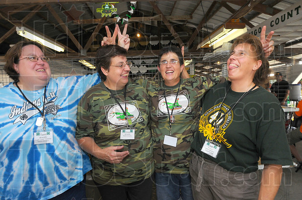 Family affair: The Brunette sisters have well over a century and a half of 4-H experience among them. Here sisters Terry Brunette, Chris Brunette, Maryann Sedletzeck and Jean Thomas give each other most appropriate bunny ears.