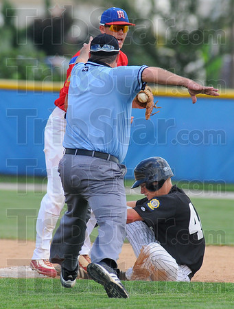 Ring him up: Kokomo baserunner Clay O'Neal sits just shy of second base while Wayne Newton shortstop Jacob Hayes shows the umpire he still has the ball.