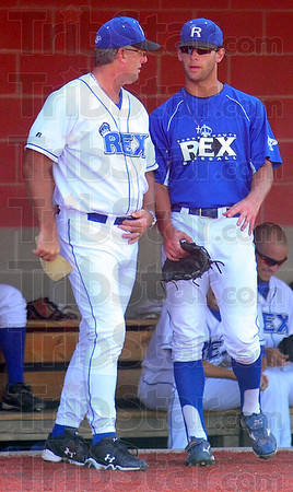 Teamed up: Rex manager Brian Dorsett talks with his son Brandon prior to Sautrday's game with the Dubois County Bombers.