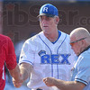 Pregame: Rex manager Brian Dorsett greets the Dubois County manager as they meet with the umpire before Saturdays game at Bob Warn Field.