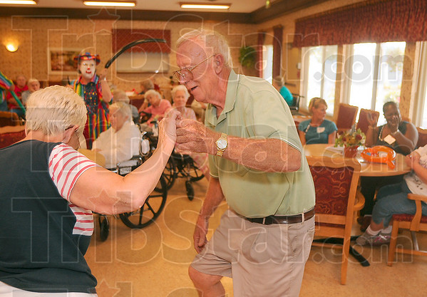 """Tribune-Star/Joseph C. Garza<br /> Providing a """"fair"""" amount of entertainment: Donna and Dick Bredeweg show off their dancing skills for the residents at Springhill Village Tuesday. The couple were on hand to provide entertainment as part of Fair Week at Springhill Village."""
