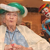 Tribune-Star/Joseph C. Garza<br /> Clownin' around: Springhill Village resident Mary Purdy sports a balloon hat that was crafted by Zip, a.k.a. Jim Hoge of Paris, Ill., right, as part of Fair Week at the facility Tuesday.