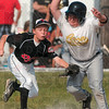 Tribune-Star/Joseph C. Garza<br /> Off base and off guard: Riley's Lukas Johnson tags out Avon's Carson Ebert after Johnson caught him off third base during the Cal Ripken ten-and-under Central State tournament championship game in Riley Tuesday.