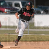 Tribune-Star/Joseph C. Garza<br /> Third base bound: Riley's Will Hayes steps on second base as he sprints to third base during the Cal Ripken ten-and-under Central State tournament championship game Tuesday in Riley.