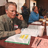 Tribune-Star/Joseph C. Garza<br /> Workin' the phone: Hans Nowak calls a potential new Chamber of Commerce member during a membership drive Tuesday at Clabber Girl.