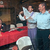 Tribune-Star/Joseph C. Garza<br /> This is how you do it!: Jimmy Cusano of Your Chamber Connection congratulates Paul Thrift on recruiting 13 new members to the Chamber of Commerce during a membership drive Tuesday at Clabber Girl.