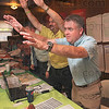 Tribune-Star/Joseph C. Garza<br /> You the man, Paul: Brendan Kearns, right, and Jim Bertoli playfully hail Paul Thrift after it was announced that Thrift had the highest number of new recruits for Chamber of Commerce memberships Tuesday at Clabber Girl.