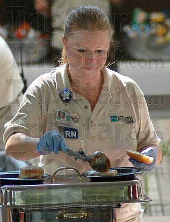 BBQ: Regional Hospital Registered Nurse Jennifer Adams builds BBQ sandwiches during Regional Hospital's Block Party Tuesday afternoon.