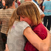 Too long since the last hug: Rockville Correctional Facility offender Lola Fier holds her daughter, Randi Fier, 14, after the CLIFF-WHAT graduation program Thursday at the facility.