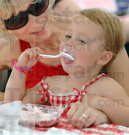 Berry good stuff: Two-year-old Kenzie Zigler enjoys some strawberries and ice cream Thursday afternoon as she and her mother Misty Zigler attend the annual First Congregational Church Strawberry Festival.
