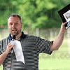 Fair: Doug Edge shows the media packet to those in attendance at the Vigo County Fair meeting Thursday evening.