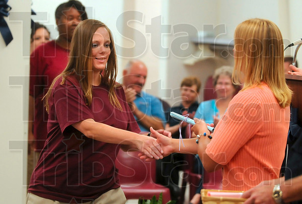 The courage to complete the course: Rockville Correctional Facility offender Amy Grimm is congratulated for completing the CLIFF-WHAT program Thursday at the facility.