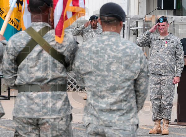 Tribune-Star/Joseph C. Garza<br /> Retiring of the colors: Lt. Col. William D. Hibner, Newport Chemical Depot commander, right, salutes after giving the command to retire the colors at the end of the depot's deactivation ceremony Thursday at the depot.
