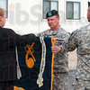 Tribune-Star/Joseph C. Garza<br /> The end of an era: Lt. Col. William D. Hibner, center, commander of the Newport Chemical Depot, rolls up the flag of the depot with help from Chemicals Materials Agency Director Conrad Whyne as Sgt. Major Ricardo Soto holds the flag's staff during the depot's deactivation ceremony Thursday.