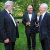 Time to relax:  Taking time to connect at the garden party prior to last week's Chamber of Commerce gala were Archie Kappel, Charlie Williams and Curt Brighton.