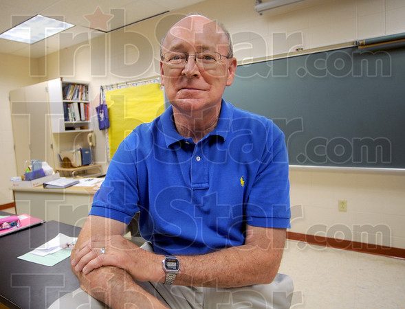 Retiring: John Treager sits in his Honey Creek classroom Thursday afternoon just prior to his last class as a science teacher after 43 years.