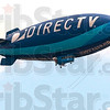 Get noticed: The Direct TV blimp cruises over Hulman Field early Thursday afternoon on its way to St. Louis.