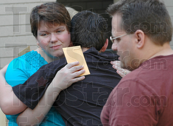 Comfort: Linda Vicory comforts her son Michael Jr. Thursday morning at Quabache School. Husband and father at right is Michael Vicory.