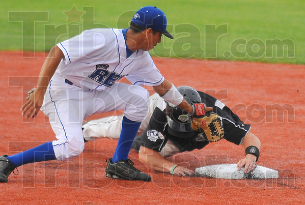 Stick with it: Rex shortstop Ray Hernandez keeps the tag on Sliders baserunner Cody Ferrell as he slides past second base. Ferrell was out on the play.