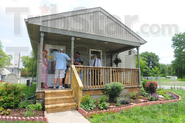 Home sweet home: The Rivera family took possession of their new home Sunday afternoon. The is the third time Habitat For Humanity has rehabbed a home for a family. The organization took out a bedroom and added a bath for the Riveras.