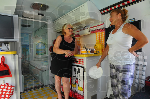 Meet and greet: Mindy Houser chats with fellow camper Linda Tilghman of Ashland Tennesse. Houser and her husband Glen are from Terre Haute and spent the weekend in their Airstream Argosy named Private Paradise at the vintage trailer get together at Sullivan County Park and Lake.