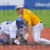 Thief: Derick Daniel slides safely into secondbasae as Miner second baseman Brent Zimmerman can't hold on to the ball.
