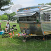 Shiny: Donna Bowlby, seated, talks with other vintage trailer owners at the end of the weekend Sunday afternoon. Her trailer is a 1976 Fan Luxury Liner.