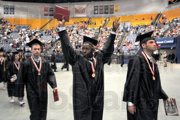 Triumphant: A graduating senior from Terre Haute South raises his arms in triumph as he leaves Hulman Center Sunday afternoon.