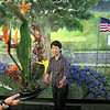 Thank you: Hero's Mural artist Patt Grigg is presented with a flower arrangement at the dedication ceremony at the American Red Cross Wabash Valley Chapter.