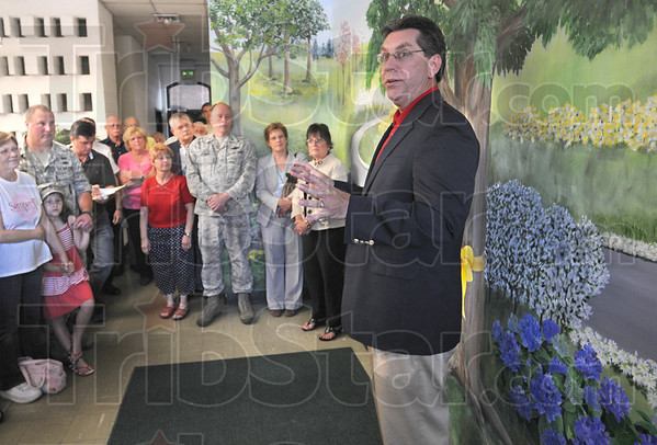 Marine father: Mayor Duke Bennett talks with gathering about his Marine father at the dedication of the Hero's Mural at the American Red Cross Wabash Valley Chapter lobby Friday morning.