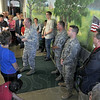 Hero's Mural: Colonel Chris Colbert of the 181st Air National Guard speaks with those at the dedication of the Hero's Mural Friday morning.